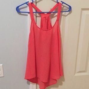 Peach colored shirt
